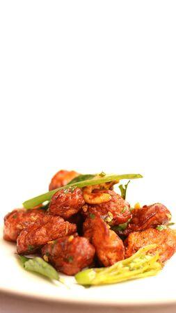 Mushroom 65, an Indian tasty starter recipe on white background.