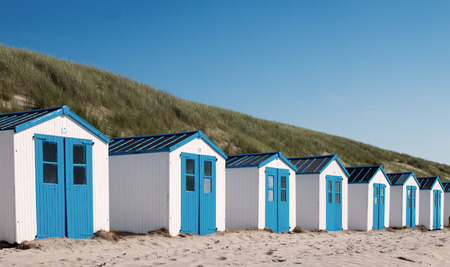 mersea: Blue and white  wooden beach huts