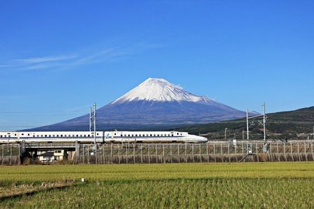 The Tokaido Shinkansen bullet train passes below Mt. Fuji in Japan.