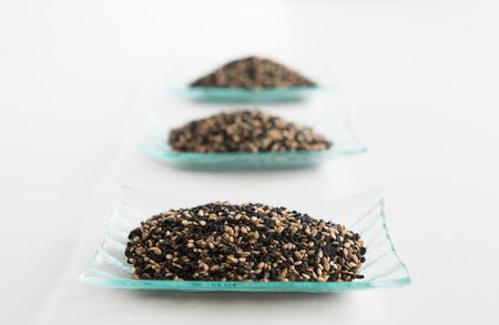 white sesame seeds: Three little trays of black and white sesame seeds