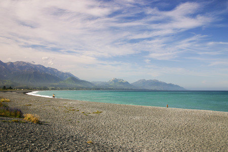 kaikoura: People having fun at a beach, South Island of New Zealand Stock Photo