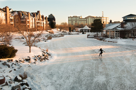 figure skater: Lone figure skater  on a frozen lake at early evening