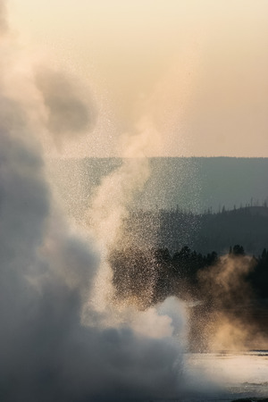steam jet: Steam and spray of a geyser in Yellowstone National Park, Wyoming, USA Stock Photo