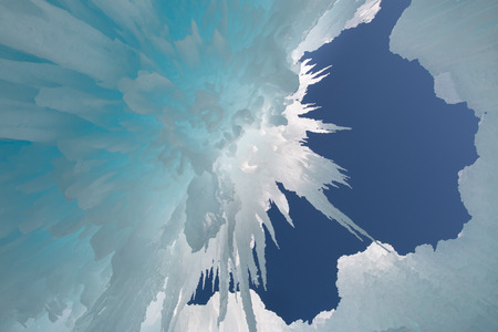 icily: View of the blue sky through the hanging icicles