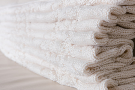 coverlet: White knitted throw folded in layers