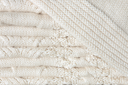 coverlet: White knitted blanket folded in layers