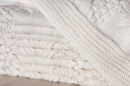coverlet: Folded white knitted linen Stock Photo
