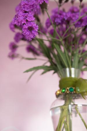 glass vase: Purple garden flowers in glass vase
