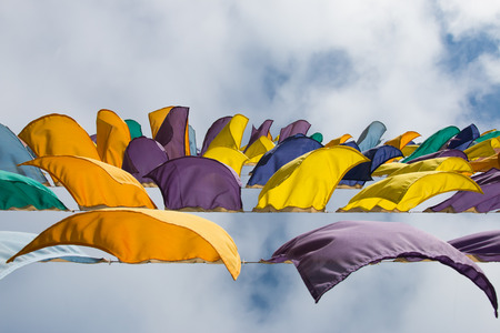 fluttering: Colorful flags fluttering in the wind