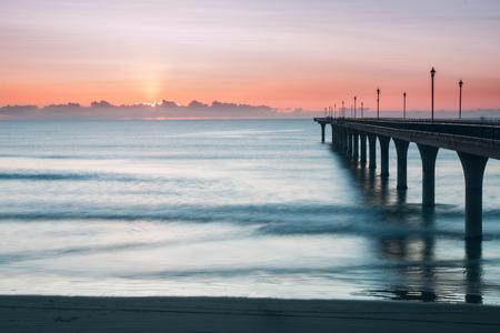 sunrise: New Brighton Pier at sunrise Christchurch New Zealand