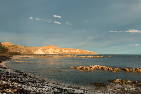 mudstone: Picturesque South bay at sunset, Kaikoura, New Zealand