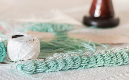 laborious: Knitting with threads with strung turquoise beads