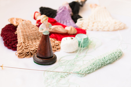 laborious: Doll mannequin and threads of beads on craft working place Stock Photo