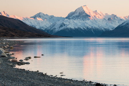 sunrise lake: Mt.Cook lit by first rays of sun, New Zealand Stock Photo