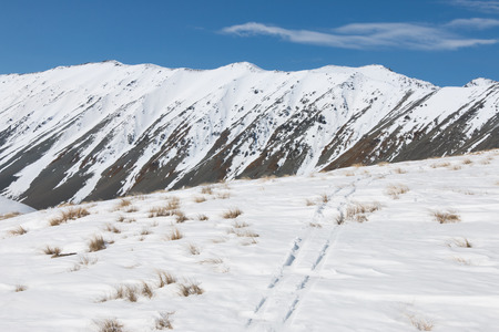 ski traces: Lone ski track on snow on mountain slope Stock Photo