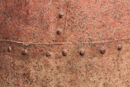 clench: Background of rusted riveted metal surface Stock Photo