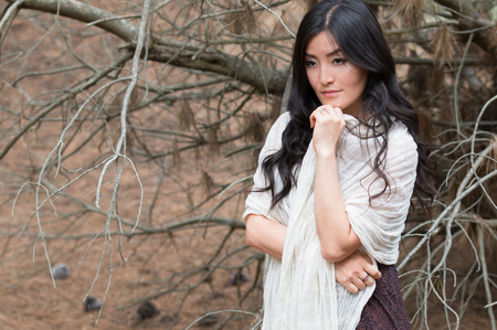 jungle girl: Young woman wrapped in a white scarf stays in orest