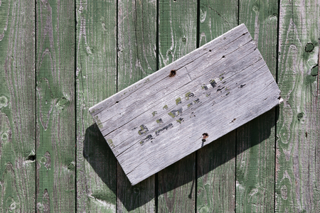 vanished: Weathered wooden door with almost vanished sign Private Stock Photo