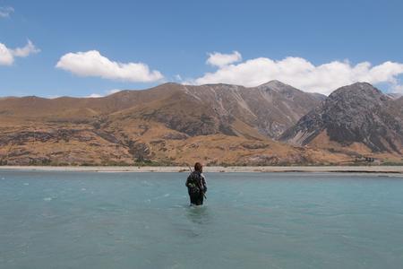 packsack: Hunter fording river, Rangitata River, New Zealand