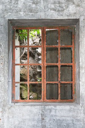metal bars: Window with metal bars in abandoned building