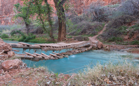 riverine: Hand-made bridge over small river in a canyon, Supai, Arizona, USA