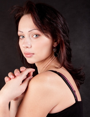 eastern european ethnicity: The model is in the center of the frame. She look at the camera. Black background Stock Photo