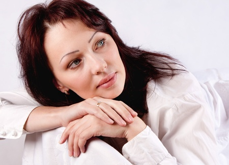 eastern european ethnicity: The model is in the center of the frame. She does not look at the camera. White background. Stock Photo