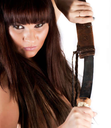 Portrait of a woman with a swordPortrait of a young long-haired woman with a sword. White background photo