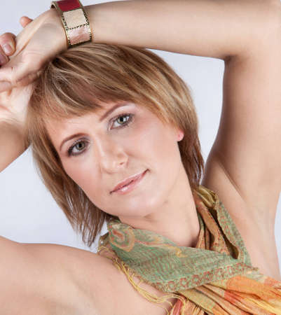eastern european ethnicity: Young woman nordic type looks straight into the camera, lifting his hand up. White background