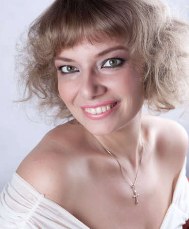 eastern european ethnicity: Green-eyed young woman looks into the camera and beautiful smiles. White background Stock Photo