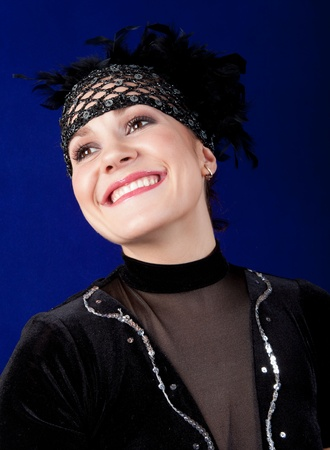 eastern european ethnicity: A young woman dressed in a costume of the dancer in the style of Chicago. Background blue.
