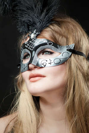 eastern european ethnicity: face of the young woman close up in a theatrical mask Stock Photo