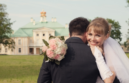 bride put her face on a shoulder of the groom photo