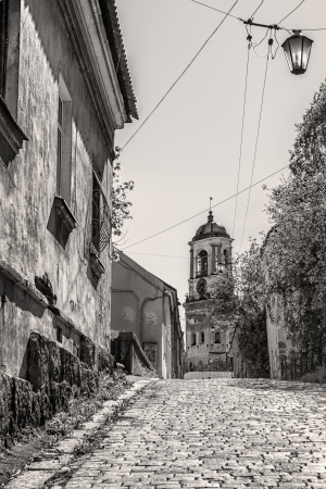 vyborg: Narrow ancient street conducts to the Hour tower. Stock Photo