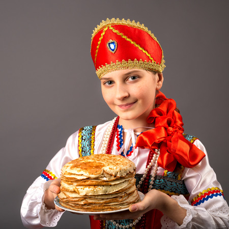 affability: girl is in the Russian national suit on a gray background Stock Photo