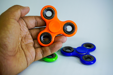 Colorful fidget finger spinner stress, anxiety relief toy Stock Photo
