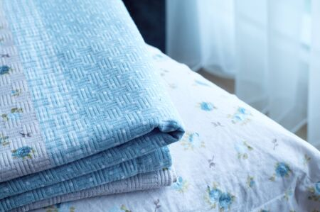 Decorative flax linen bed sheets on bed. Home decoration or bedroom decoration concept. 스톡 콘텐츠