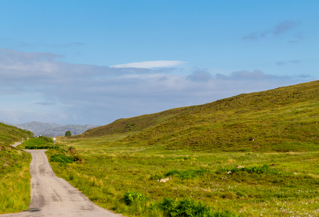 Road surrounded by beautiful landscape of the Scottish Highlands