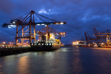 Container vessel MSC Spain unloading at the container terminal Eurokai in Hamburg, Germany on May 23rd, 2017 at night