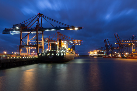 unloading: Container vessel MSC Spain unloading at the container terminal Eurokai in Hamburg, Germany on May 23rd, 2017 at night