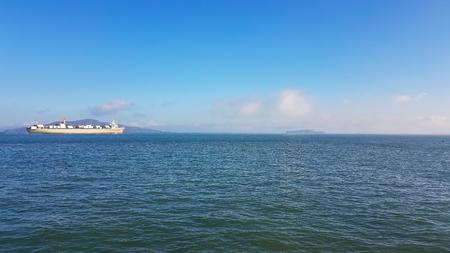 alcatraz: Container Ship in the Bay of San Francisco approaching the island of Alcatraz