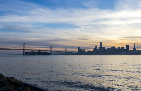 The Bay Bridge and skyline of San Francisco during sunset