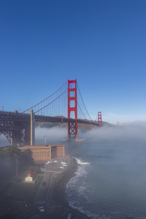 The Golden Gate Bridge surrounded by fog