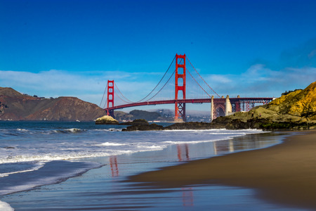 Golden Gate Bridge in San Francisco from Baker Beach Фото со стока
