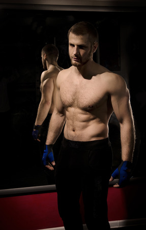 The young man, who is engaged in the fitness club. photo