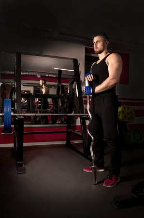 dumb bells: The young man, who is engaged in the fitness club. Stock Photo
