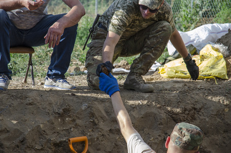 casualty: Excavations of burial of soldiers of the Second World War. Kakhovka. Ukraine. 06.24.2017.