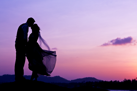 happy bride: wedding couple with the sunset