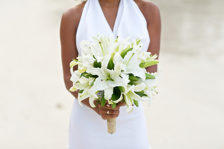 beautiful bride: the bride holding the wedding bouquet