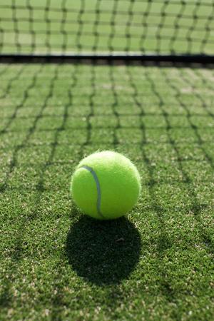tennis balls on tennis grass court Stock Photo